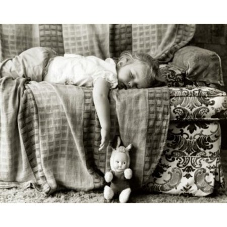 Side profile of a baby girl sleeping on a couch Canvas Art - (18 x 24)