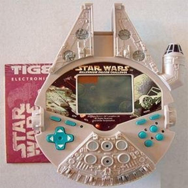 Star Wars Millenium Falcon Handheld Electronic Game by Tiger Electronics
