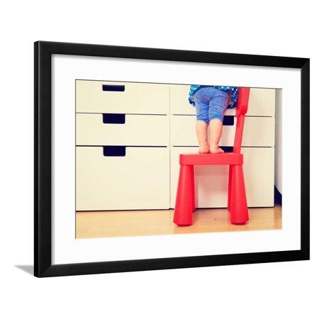 Childrens Climbing Frames - Kids Safety Concept- Little Girl Climbing on Baby Chair Framed Print Wall Art By NadyaEugene