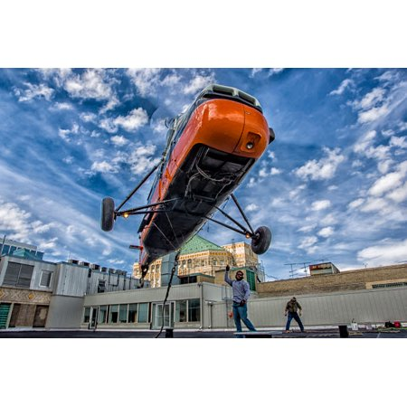 An S-58T picks up the lifting line on the top of a building in Chicago Illinois Poster Print by Rob EdgcumbeStocktrek
