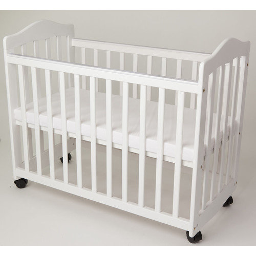 L.A. Baby Bedside Manor Compact Cradle Convertible Crib with Mattress