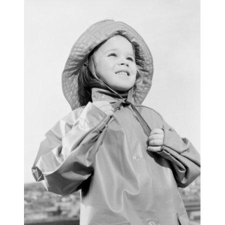 Girl wearing raincoat and rain hat Canvas Art - (24 x 36)