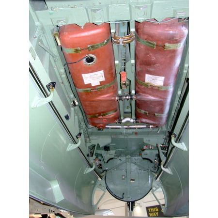 Canvas Print Extra long-range fuel tanks in the bomb bay of De Havilland Mosquito TJ138, at the Royal Air Force M Stretched Canvas 10 x (Top 10 Places To Be Bombed In America)