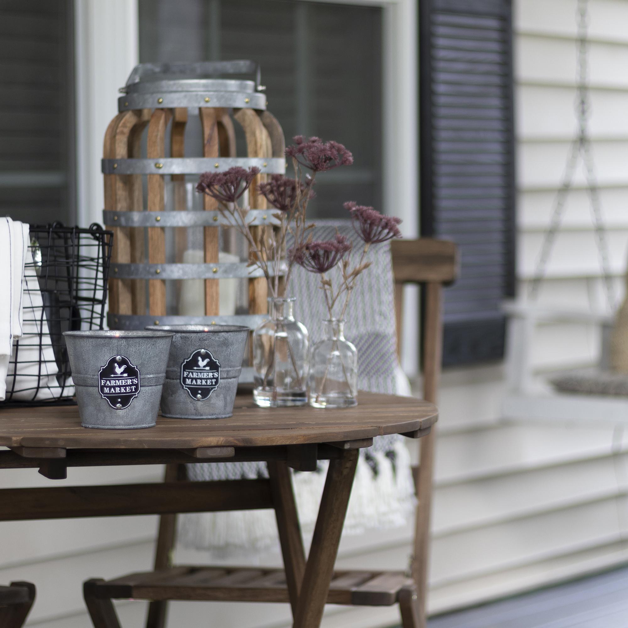 Citronella candles in galvanized farmhouse buckets
