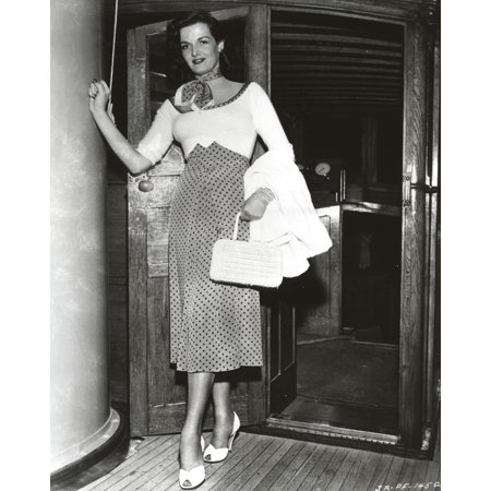 Jane Russell Posed in Scoop-Neck Long Sleeve Dress with Polka Dot High Waist Skirt while the Left Hand Holding a White Handbag Photo - Rydell High