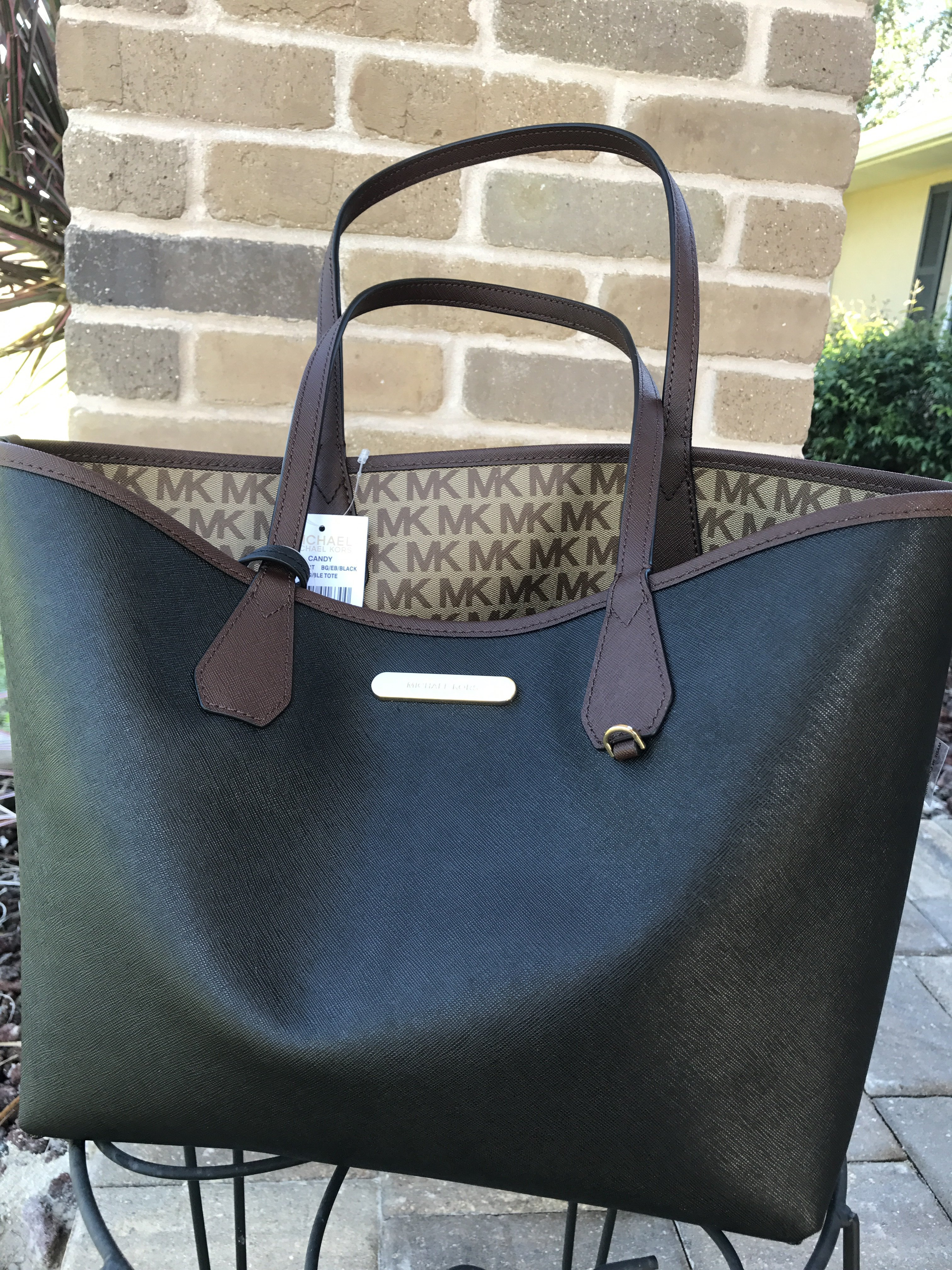 ff62fd75df59 ... top quality michael kors candy large reversible tote brown signature  black pouch mk logo walmart 691ba