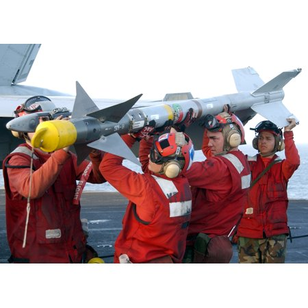 At sea aboard USS John F. Kennedy (CV 67) Mar. 19, 2002Aviation Ordnancemen assigned to the Wil Poster Print 24 x 36