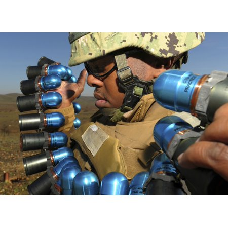 Paso Robles California January 30 2013 - Soldier readies 40mm grenades to fire from the Mk19 grenade launcher during a weapons qualifications and familiarization exercise held at Camp Roberts Poster -