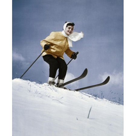Low angle view of young woman skiing downhill Canvas Art - (18 x 24)