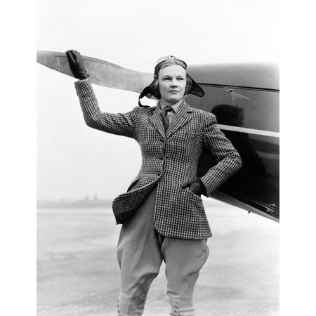 1930s Woman Aviator Pilot Standing Next To Airplane One Hand On Propeller Flight Goggles Cap Tweed Suit Fashion Print By](Aviator Goggles And Hat)