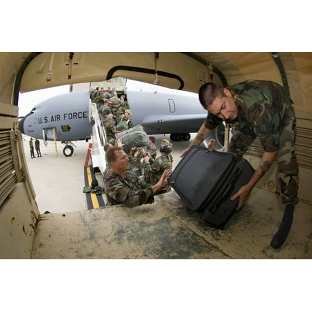 LAMINATED POSTER Members of the Iowa Air National Guard's 185th Air Refueling Wing unload their gear at the Eastern I Poster Print 24 x