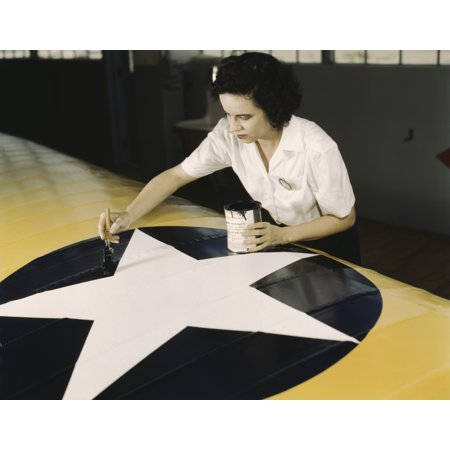 Navy Wings Insignia (A female worker paints the American insignia on a Navy plane wing 1942 Poster Print by Stocktrek Images )