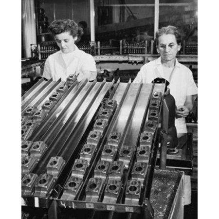 Two female workers using air gauge to sort cylinders used in a household refrigerator compressor Stretched Canvas -  (18 x 24)