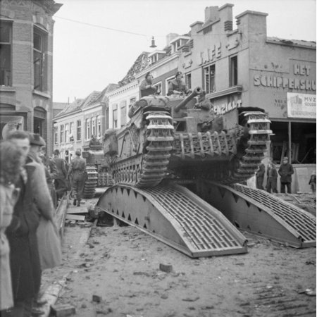 LAMINATED POSTER Churchill tanks of 34th Tank Brigade cross a temporary bridge in Roosendaal, Netherlands. Poster Print 24 x 36