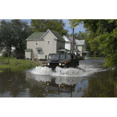 A humvee drives through the floodwaters in Salisbury Maryland Poster Print - Party City Salisbury Maryland