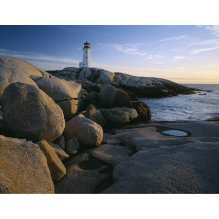 Peggys Cove Lighthouse in the evening on the Atlantic coast of Nova Scotia Canada Poster Print