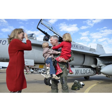 Virginia Beach Virginia December 18 2012) - US Navy aviator is reunited with his wife and children during a homecoming celebration for the squadron VFA-131 part of Carrier Air Wing 7 Poster Print - Kids Aviators