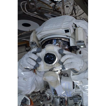 Astronaut uses a digital still camera during a spacewalk Poster Print by Stocktrek (Autofocus Still Image)