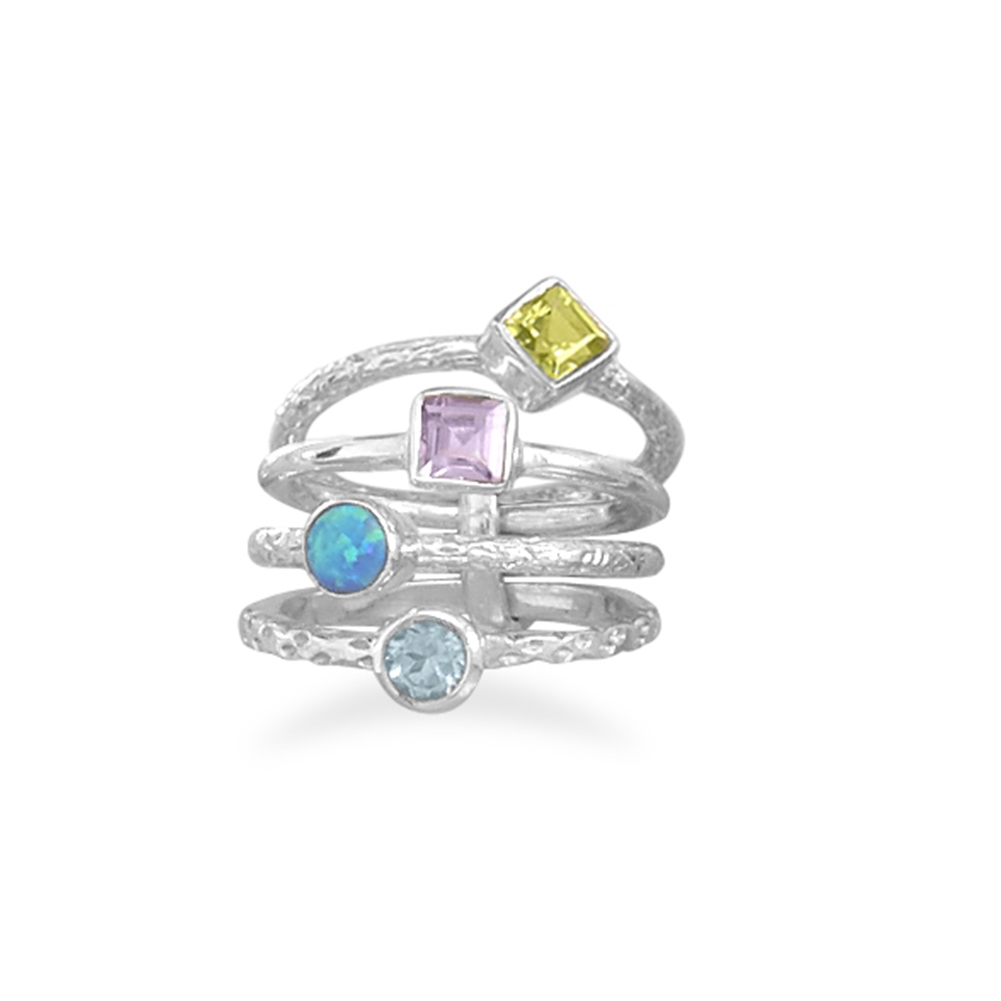 Stackable Ring set with Amethyst, Topaz, Peridot, and Synthetic Blue Opal by unknown