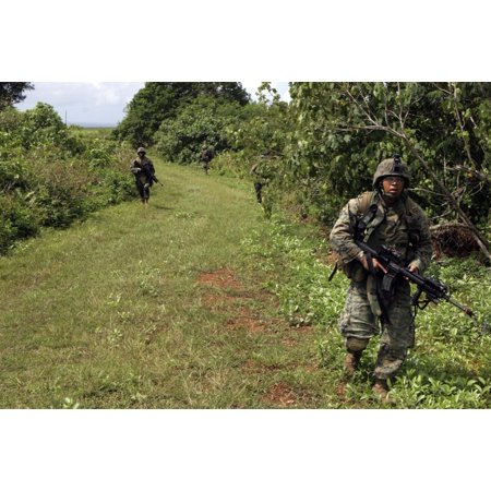 January 24 2006 - A Marine leads the way on a patrol through the jungles of Guam as they conduct a HELO Raid exercise Poster Print