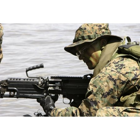 - October 10 2005 - Marine provides front security with his M-240G medium machine gun during a boat raid exercise off the coast of Guinea Poster Print