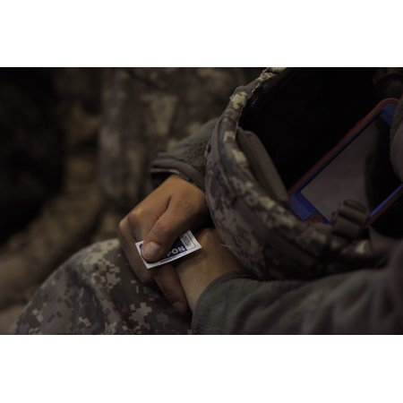 LAMINATED POSTER An U.S. Army soldier from the 82nd Airborne Division waits in hope that his lottery ticket number wi Poster Print 24 x 36