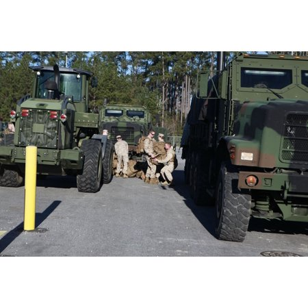 LAMINATED POSTER Marines with Marine Wing Support Squadron 271 pass bags down a line to be loaded into a 7-ton truck Poster Print 24 x 36