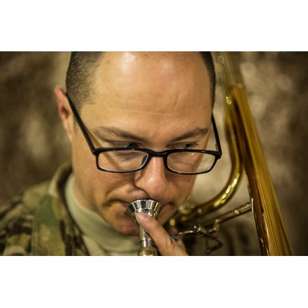 LAMINATED POSTER U.S. Army Staff Sgt. Brad Leja, member of U.S. Air Forces Central Band Total Force, plays the trom Poster Print 24 x 36