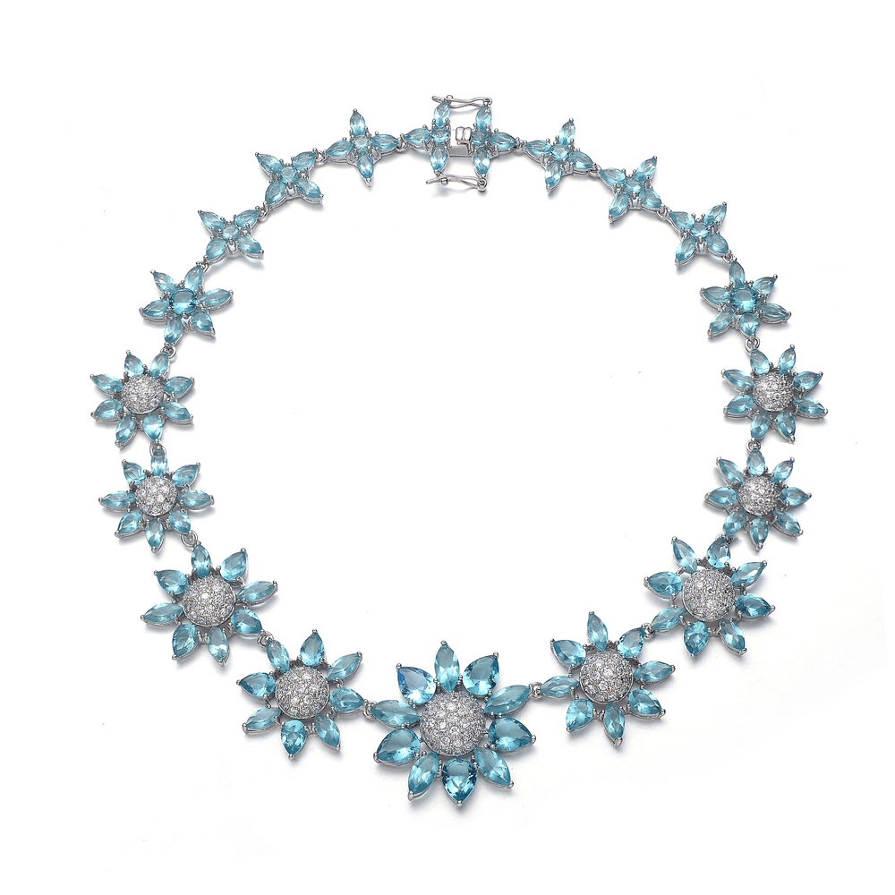 RelavenO C.Z. Sterling Silver Rhodium Plated Blue Topaz Graduated Flower Shape Necklace by