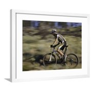 Mountain Biker Against a Blurry Background, Mt. Bike Framed Print Wall Art By Michael Brown