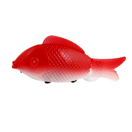 Red white plastic swinging tail electronic swimming fish for Fake fish that swim