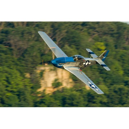 A P-51 Mustang flies along the Mississippi at Dubuque Iowa Poster Print by Rob EdgcumbeStocktrek Images ()