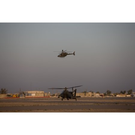 Tikrit Iraq   An Ah 64D Apache Longbow Block Iii Attack Helicopter Waits For An Oh 58 Kiowa To Clear His Flight Space Poster Print