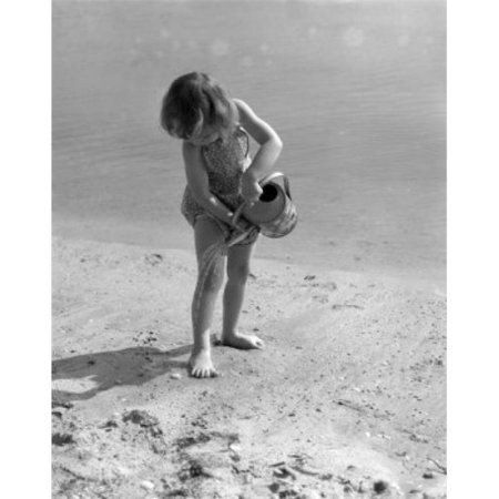 Posterazzi SAL25514285 Girl Playing on Beach with Watering Can Poster Print - 18 x 24 in. - image 1 of 1
