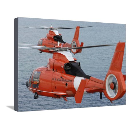 Two Coast Guard HH-65C Dolphin Helicopters Fly in Formation Over the Atlantic Ocean Stretched Canvas Print Wall Art By Stocktrek Images