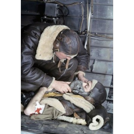 Close-up of a soldier putting an oxygen mask to an injured soldiers face Canvas Art - (24 x 36)