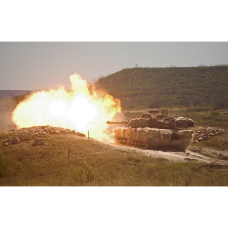 Canvas Print A burst of fire erupts from the muzzle of a 2nd Armored Brigade Combat Team, 1st Cavalry Division M1 Stretched Canvas 10 x 14