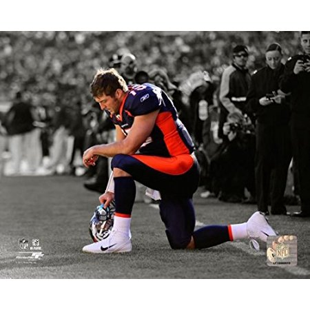 Tim Tebow 2011 Spotlight Action Photo Print  8 X 10   Exhibition Quality 8X10 Photograph Professionally Produced In State Of The Art Photographic    By Photo File Usa