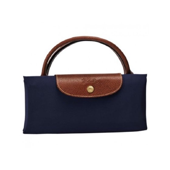 0fda495e99e7 Features  Navy Made of nylon Snaps and zipper closure Measures 21.75 inches  x 15.75 inches x 9 inches Longchamp Le Pliage Extra-Large Navy Foldable Tote  Bag