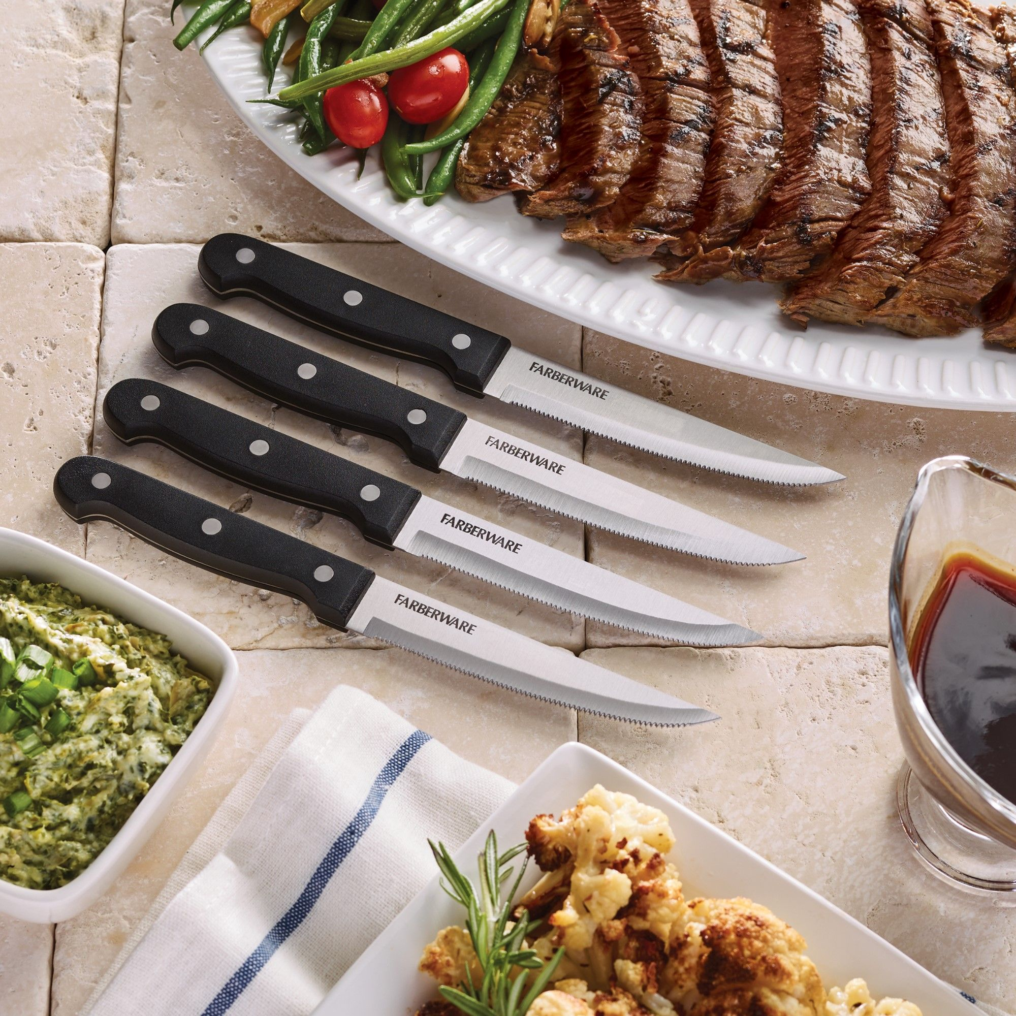 "Click here to buy Farberware 4-Piece 4.5"" Steak Knife Set by Lifetime Brands."