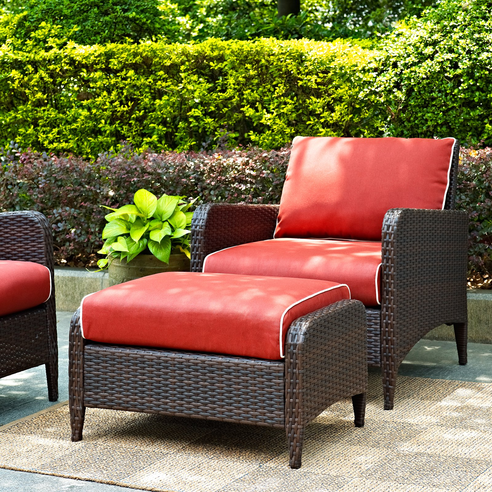 Crosley Furniture Kiawah 2-Piece Outdoor Wicker Seating Set with Sangria Cushions, Armchair with Ottoman