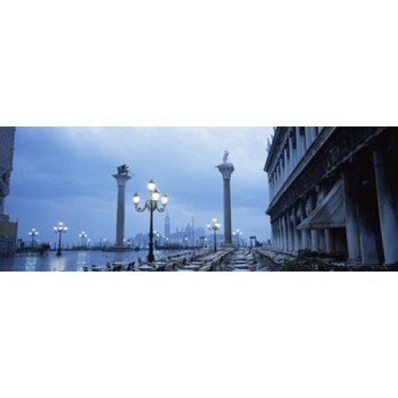 Tables and chairs at a restaurant St Marks Square Grand Canal San Giorgio Maggiore Venice Veneto Italy Poster