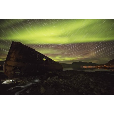 Star trails and northern lights over top the town of Djupavik in the West Fjords of Iceland Djupavik Iceland Stretched Canvas - Robert Postma  Design Pics (19 x 12)
