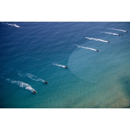 US Marine amphibious assault vehicles practice a beach assault in Busan South Korea Poster Print by Stocktrek