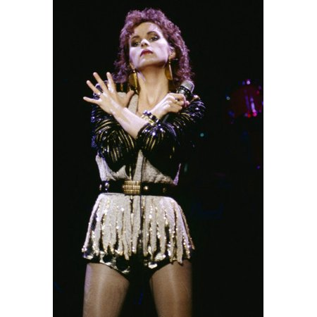 Sheena Easton in concert 1980's in short outfit arms across chest 24x36 Poster