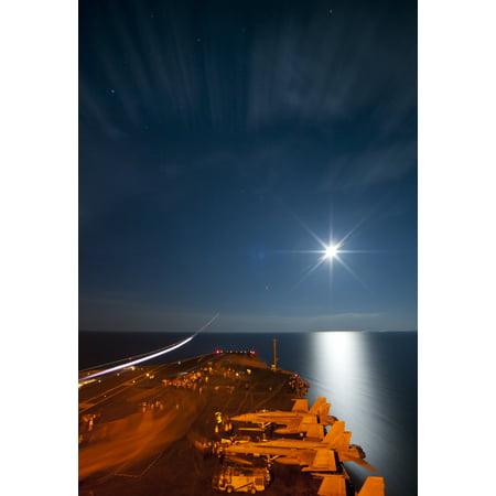 LAMINATED POSTER The Nimitz-class aircraft carrier USS Carl Vinson (CVN 70) conducts night flight operations. Carl Vi Poster Print 24 x - Halloween Night Uss Dates