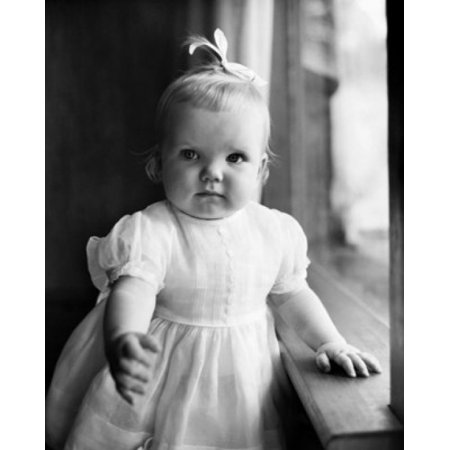 Baby girl standing near a window Canvas Art - (24 x 36)