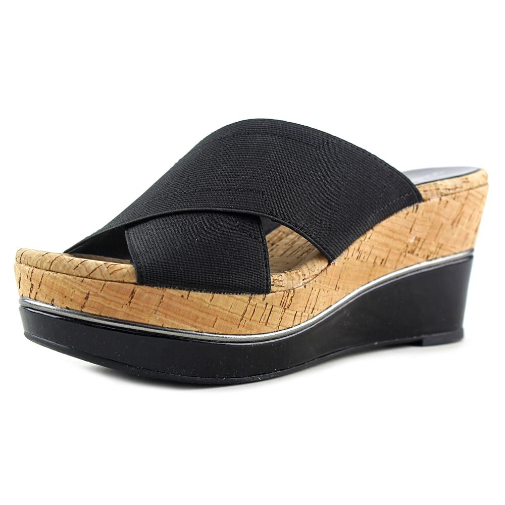 Click here to buy Donald J Pliner Dani Open Toe Canvas Wedge Sandal by Donald J Pliner.