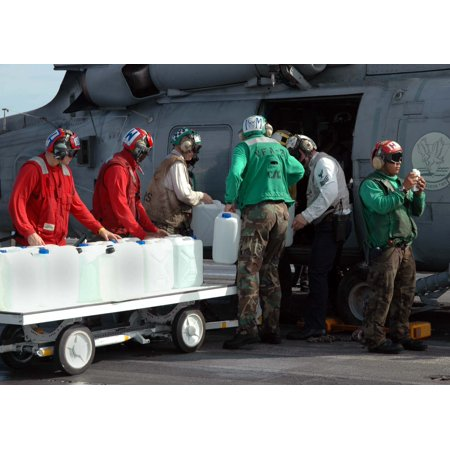 LAMINATED POSTER Sailors from Carrier Air Wing Two (CVW-2) and USS Abraham Lincoln (CVN 72) load containers of water Poster Print 24 x