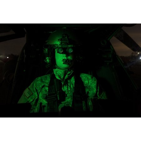 A Pilot Equipped With Night Vision Goggles In The Cockpit Of An Ah 64 Apache Helicopter Poster Print